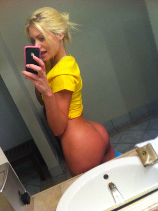 Big ass blonde selfshot herself with iPhone in ladies room